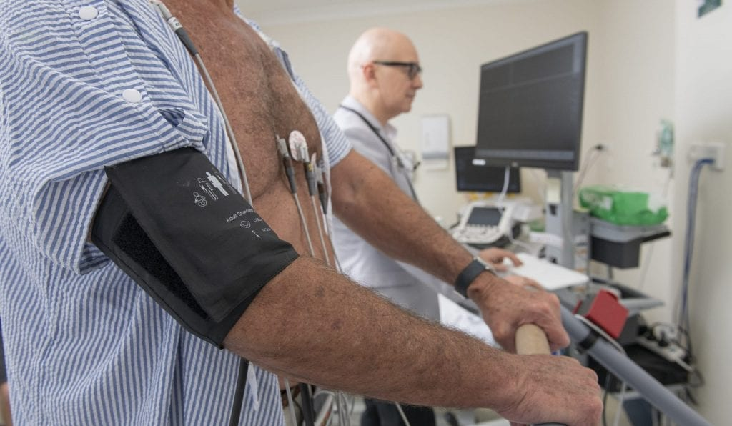 Patient taking part in a exercise stress ECG test