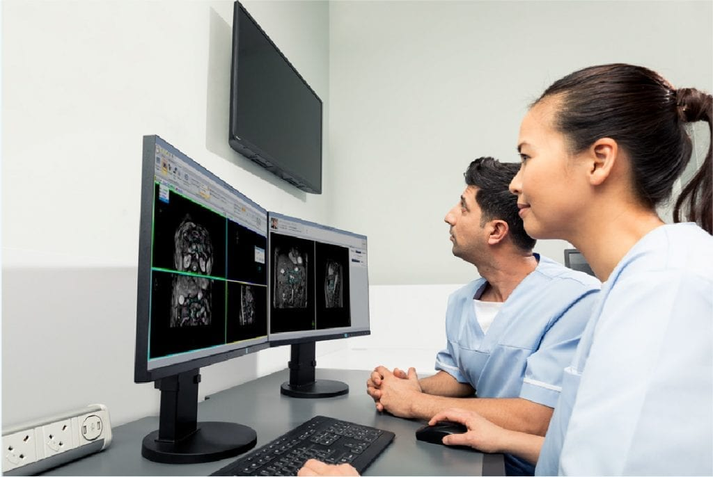 Image of doctors viewing medical scans on computer